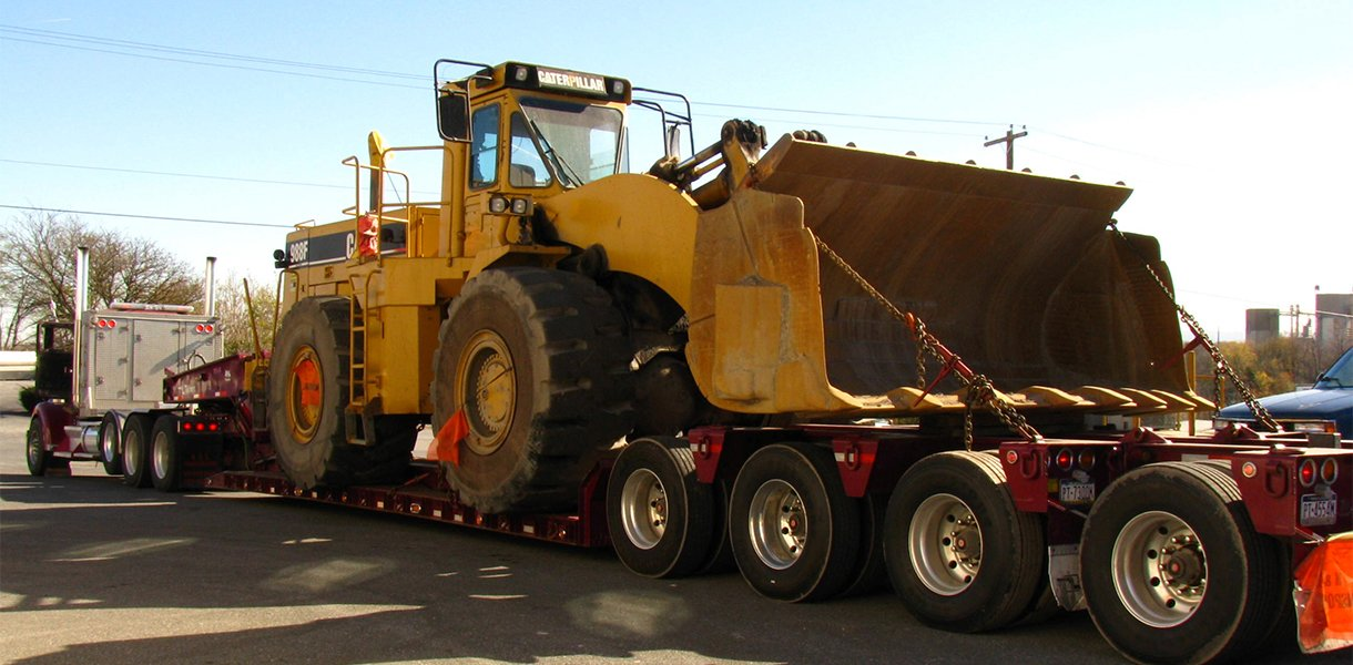 Rutt's Machine, Inc. hauling Caterpillar equipment to a customer